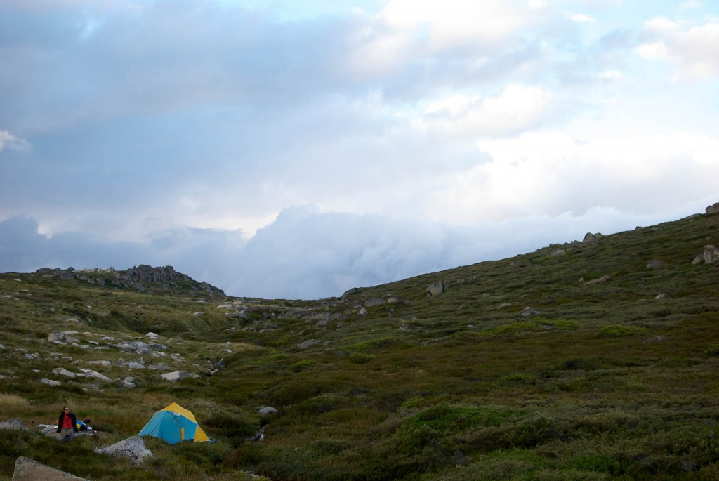 Taking in the drama of a less-than-perfect campsite, off trail from the Schlink Hut Walk, Kosciuszko NP, NSW. Photo: Roger Stuart
