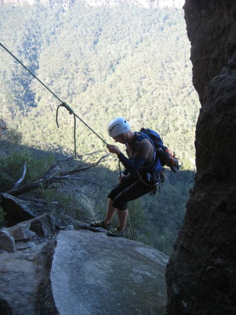 Abseiling into the howling wind, Pierces Pass, Blue Mountains, NSW
