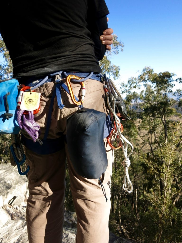 Jacket hanging from climbing harness.